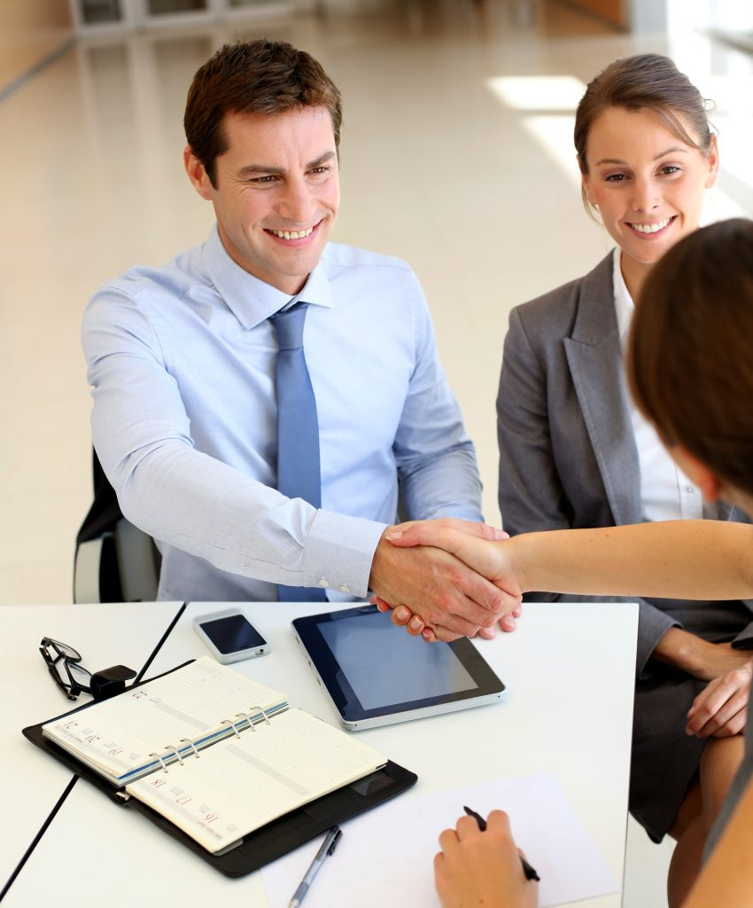 Motivated Employees and Business Associates Shaking Hands and Making Deals