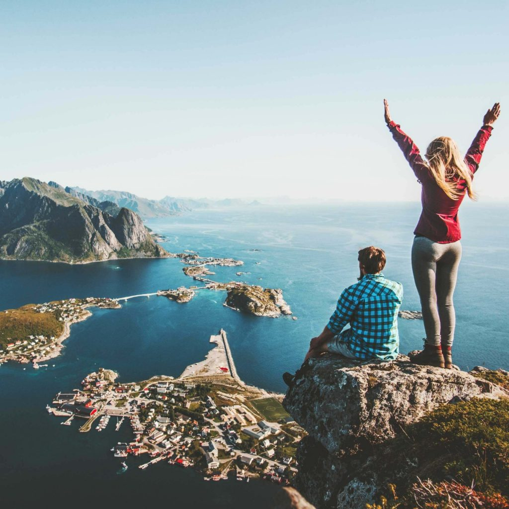 Happy People Standing on a Mountain Peak