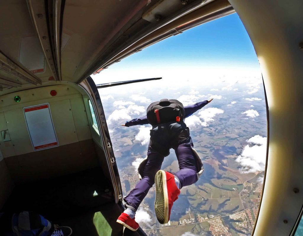 Skydiver leaping from plane