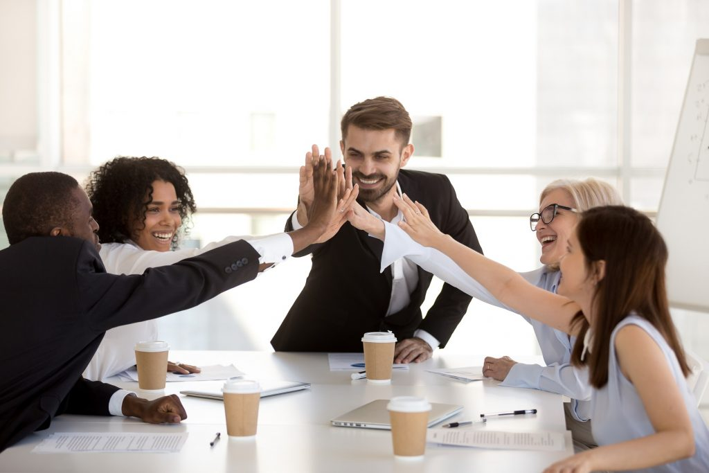 Work colleagues surrounded by positivity following meeting