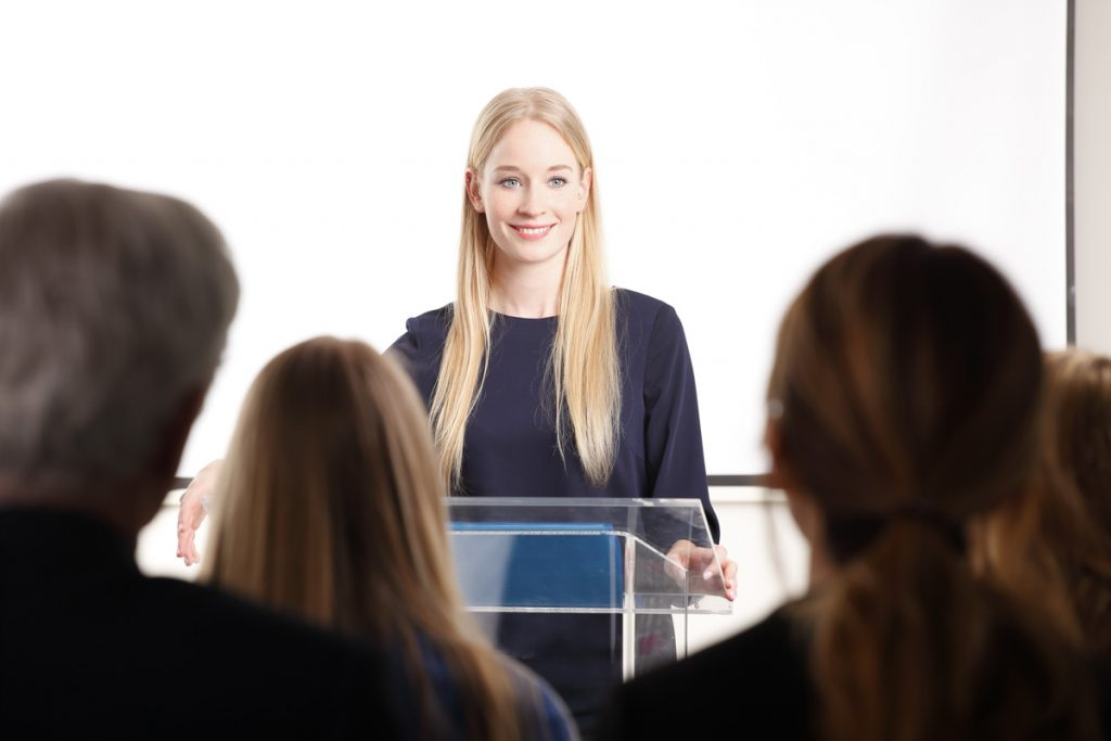 Confident, Well-Dressed Woman Giving a Business Presentation