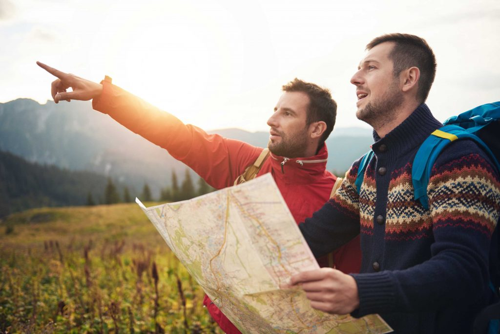 Men with map trying to find direction