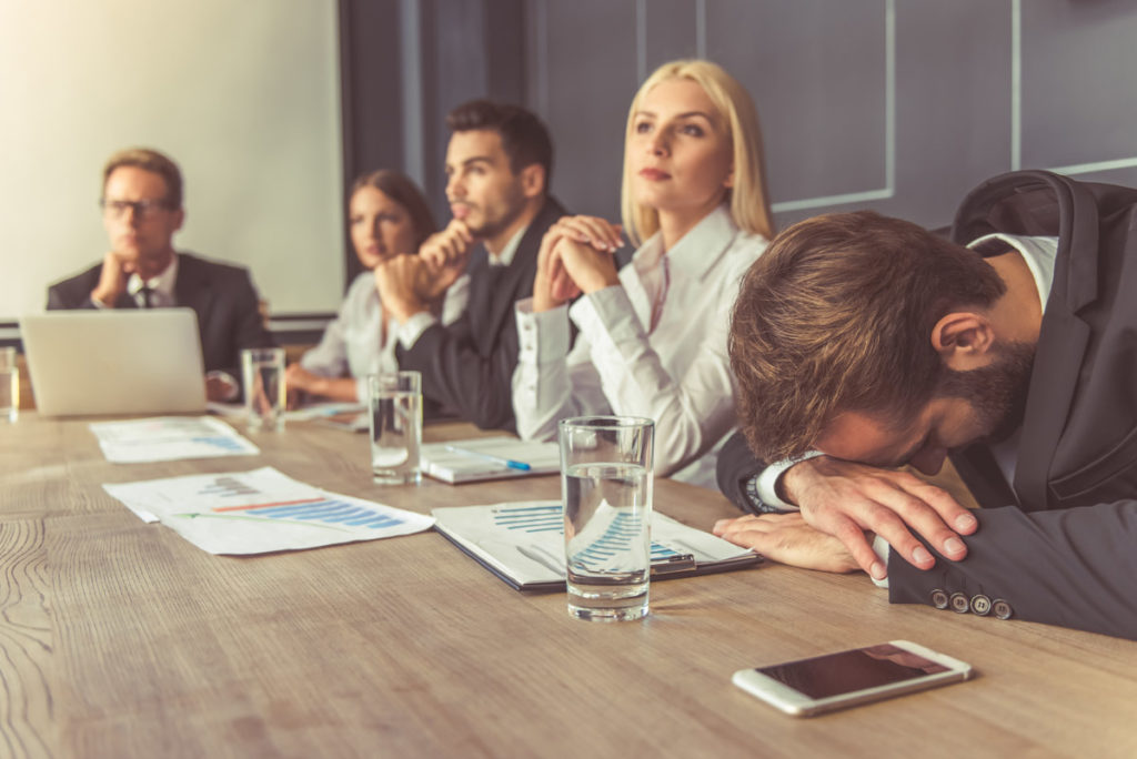 Man Looking Bored in a Meeting