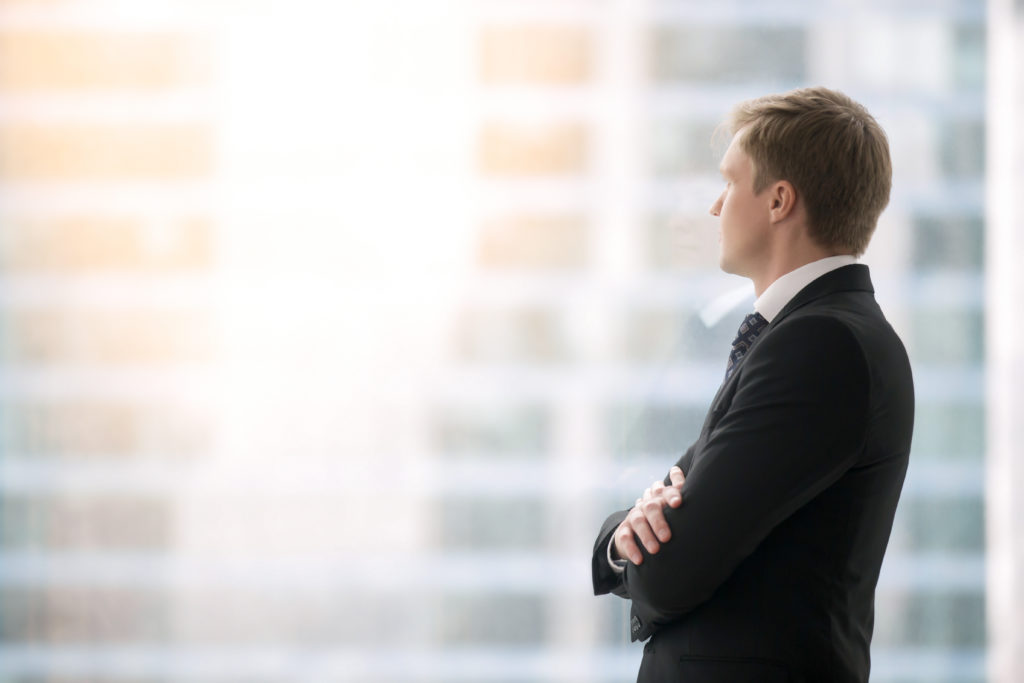 Man Standing and Reflecting on the Secret to Success