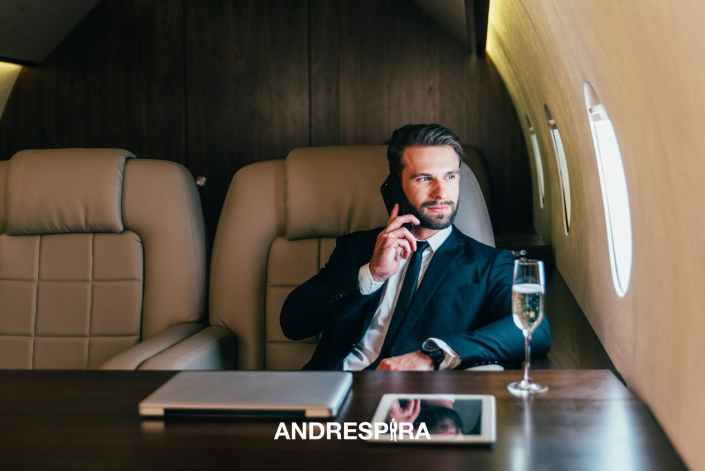 Wealthy Man Sitting in a Private Jet