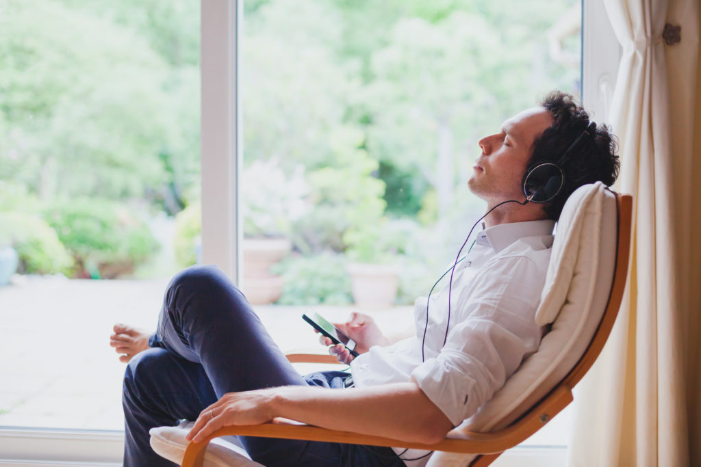 Man Listening to Uplifting Music