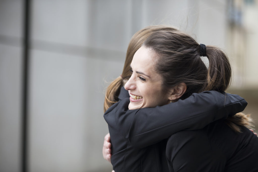 Two Women Apologizing and Hugging