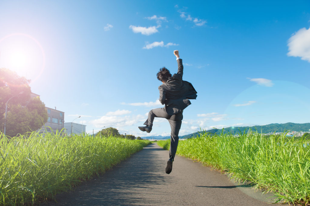 An Energetic Person Jumping Outside