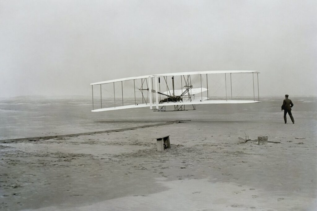 Early flying machine, black and white picture.